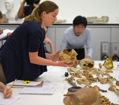 Students conduct a mock-burial activity while I explain skeletal features